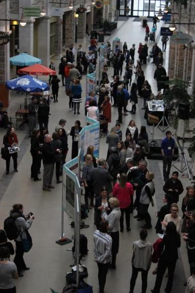 Members of the public attending a poster exhibit in the Quebec Street mall.